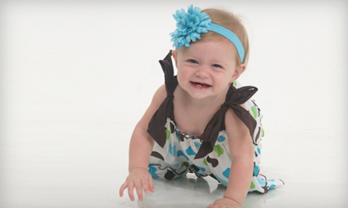 Olan Mills Portrait Studio - Russellville: $20 for a Photo-Shoot Package with Two Poses and Prints at Olan Mills Portrait Studio ($100 Value)