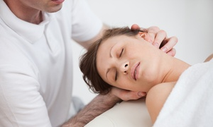 The Wellness Group of America: Chiropractic Package with Acupuncture Options at The Wellness Group of America (95% Off)