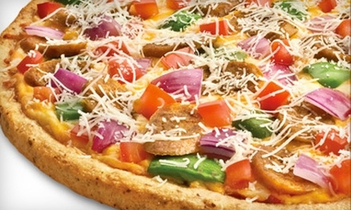 Boston Pizza - Chestermere: $12 for $25 Worth of Gourmet Pizza and Pasta at Boston Pizza