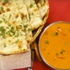 Indian Dinner with Appetizers, Naan, Entrees, and Mango Lassi for Two or Four (Up to 58% Off)