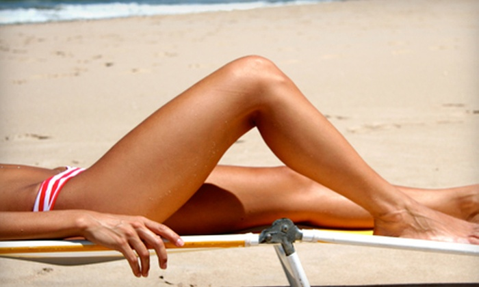 Sunroom Tanning Salon - Norman: Three UV-Tanning Sessions or Three Mystic Tan Spray Tans at Sunroom Tanning Salon in Norman