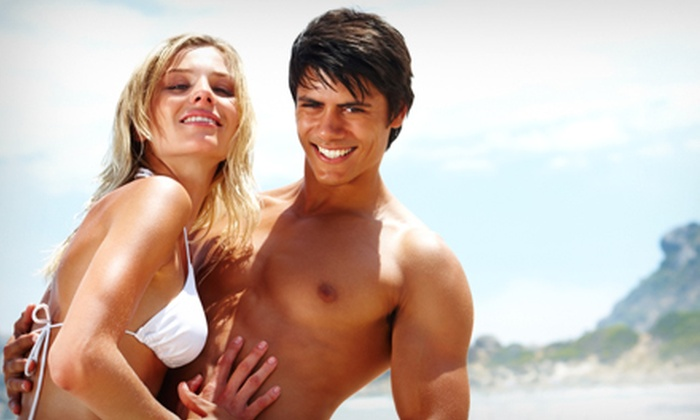 Sunny Beach Tans - Sugar Land: $30 for Three VersaSpa Spray Tans or One Month of Unlimited UV Tanning at Sunny Beach Tans (Up to $105 Value)