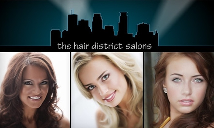 The Uptown Hair District  - Lyn-Lake: $45 for a Shampoo, Haircut, Blow-Dry, and Kerastase Restructuring Treatment at The Uptown Hair District (Up to a $135 Value)