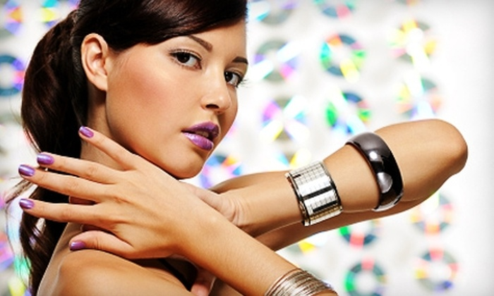 Vanity Salon and Spa - Nashville: Spa Mani-Pedi or Women's Haircut with Shampoo and Style at Vanity Salon and Spa
