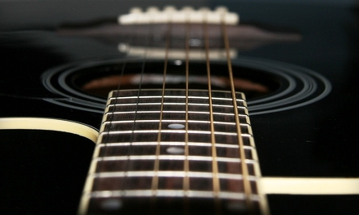 JF Music Instruction - Fair Heights: Private Guitar or Bass Lessons from JF Music Instruction. Two Options Available.