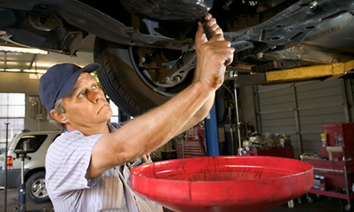 Wilcox & Son Automotive - Orlando: $27 for an Oil Change, Tire Rotation, and Vehicle Inspection at Wilcox & Son Automotive ($62.99 Value)