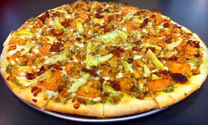 La Riviera Family Pizza - La Riviera: Pizza Dinner with Chips, Salad, and Beer or Wine for Four or $10 for $20 Worth of Pizza and Italian Fare at La Riviera Family Pizza