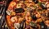 Menu paella valenciana di pesce