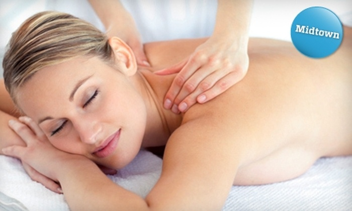 Okeanos - Midtown East: Massage Package with Spa Pass and More at Okeanos. Choose from Four Options.