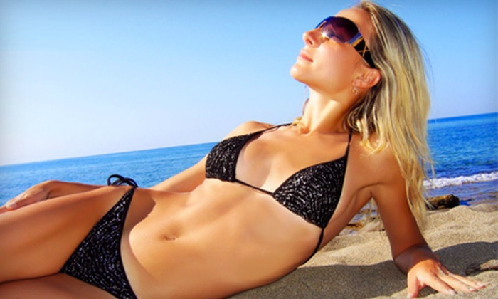 Tanz Mania Tanning - Lansing: 3 or 12 Level 2 Bronzing Bed Sessions, One Mystic Spray Tan, or Three High-Pressure Tans at Tanz Mania Tanning (Up to 67% Off)