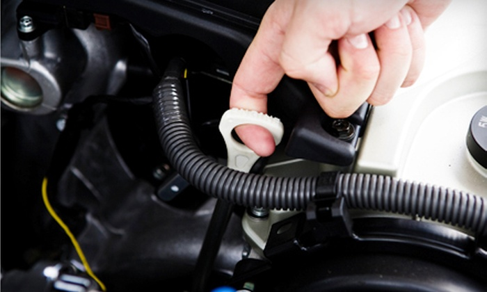 Bell's Automotive Service Jacksonville - San Jose: $42 for Three Full-Service Oil Changes with Inspections at Bell's Automotive Service ($95.85 Value)