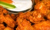 The Dog House Bar & Grill - Jungle Terrace: Pub Fare and Drinks at The Dog House Bar & Grill in St. Petersburg (Up to 53% Off). Two Options Available.