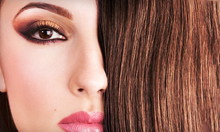 Sign of the Tymes Salon - Indianapolis: Haircut, MoroccanOil Treatment, and Blowout with Optional Color Service at Sign of the Tymes Salon (Up to 55% Off)