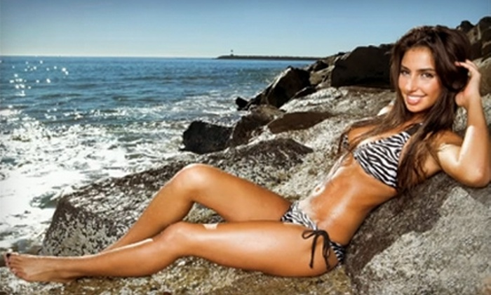 Tropical Tan - Multiple Locations: $39 for One-Month Ultra Package of Unlimited High-Pressure Tanning and Mystic Tans at Tropical Tan (Up to $129.95 Value)