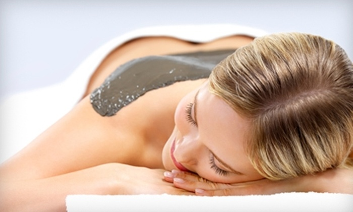 World of Wellness Day Spa - Walker: $35 for a Massage-Moisture Facial ($70 Value) or $45 for an Herbal-and-Mud Body Wrap ($95 Value) at World of Wellness Day Spa