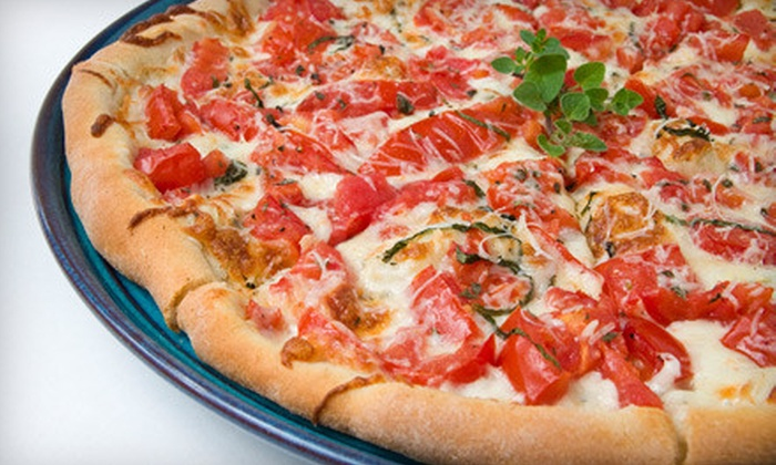 """Papa Saverio's - Cimarron: $11 for a Pizza Dinner with 16"""" Pizza, Four Breadsticks, and One 20 Oz. Soda at Papa Saverio's in Cary (Up to $23.73 Value)"""