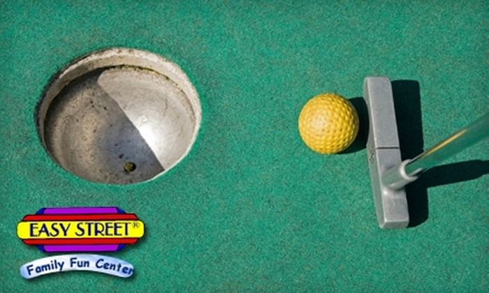 Easy Street Family Fun Center - Ocala: $24 for Four Rounds of Miniature Golf, One Large Pizza, One Pitcher of Soda and 20 Tokens at Easy Street Family Fun Center (Up to $49 Value)