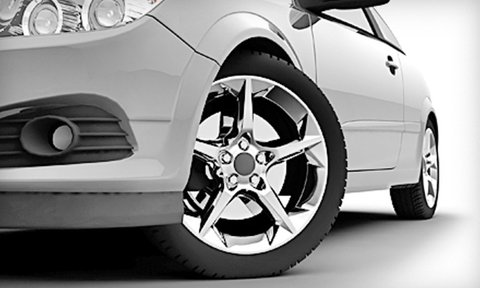 Courtesy Chrysler Jeep Dodge - Brandon: Tire Balance and Rotation or Four-Wheel Alignment at Courtesy Chrysler Jeep Dodge (Up to 71% Off)