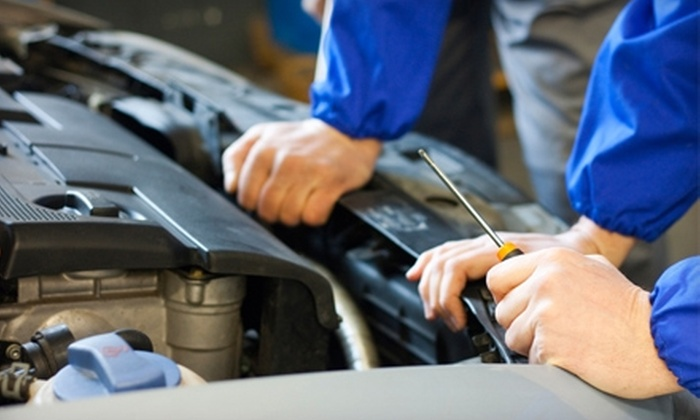 The Pit Stop Auto Repair - Kearny Mesa: $35 for Three Oil Changes, 60-Point Inspection, and Battery Check at The Pit Stop Auto Repair (Up to $105 Value)