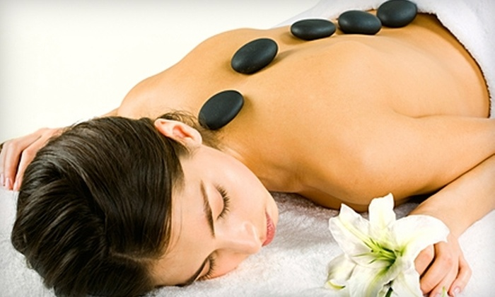 Stonebrook Day Spa - Catoosa: $67 for a One-Hour Hot-Stone Massage, Paraffin Treatment, Foot-Mask, and Foot Soak in Catoosa ($135 Value)