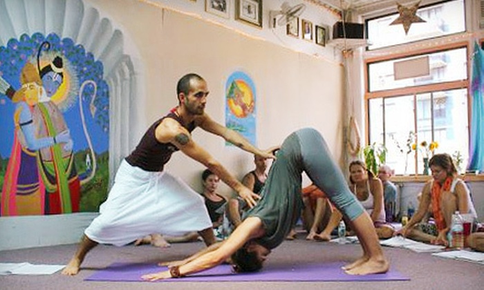 Dharma Yoga - Midtown South Central: $25 Worth of Yoga Classes