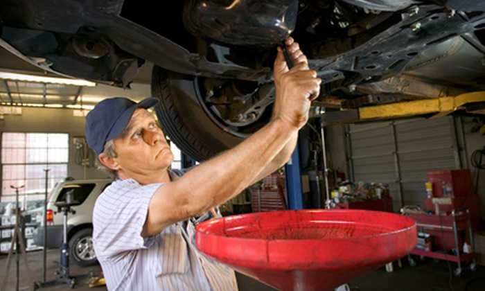 DJ's Auto Repair - Sherwood: Oil Change and 100-Point Inspection or Coolant Flush at DJ's Auto Care in Sherwood