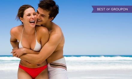 Five UV Tans in Five Different Levels of Beds or One VersaSpa or Norvell Spray Tan at Darque Tan (Up to 82% Off)