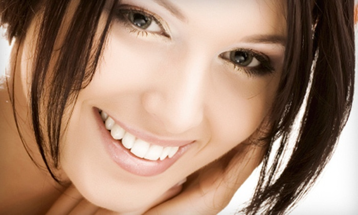 Universal Dental Clinics - Multiple Locations: Four or Six Veneers at Universal Dental Clinics (Half Off)