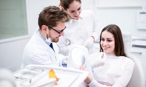 Dottor Nicola Lombardo: Pulizia, sbiancamento led, impianto in titanio con corona in resina e innesto osso (sconto fino 86%). Valido in 4 sedi