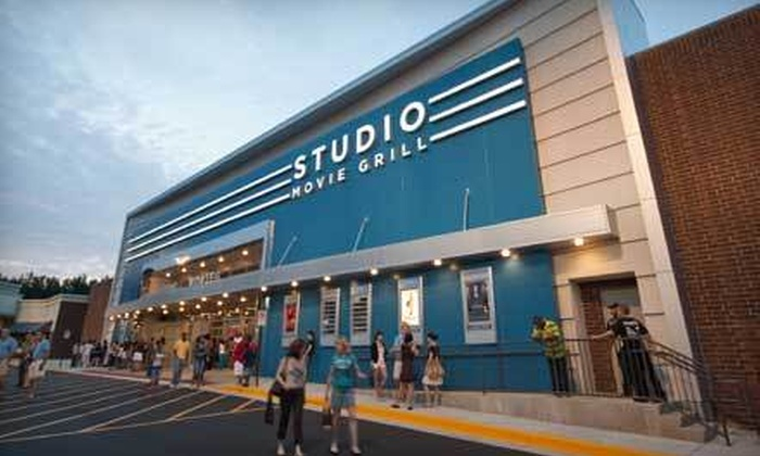 Studio Movie Grill - Holcomb Bridge: $5 for a Movie Outing with Ticket and Soda at Studio Movie Grill (Up to $12.74 Value)