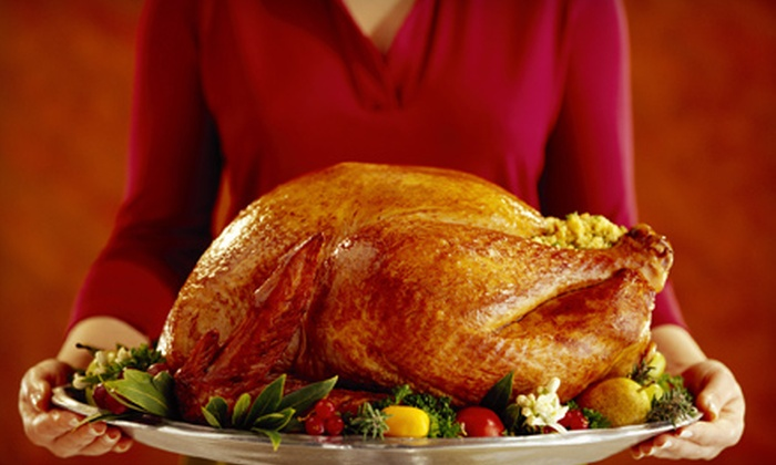 Andria's Cajun Cuisine - Thunderbird Estates: $80 for a Holiday Dinner for 12 with Smoked Bone-In Ham or Smoked Turkey from Andria's Cajun Cuisine in Plano ($165 Value)