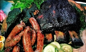 Tin Star Smoke House: Three Groupons, Each Good for $10 Worth of Barbecue, or a Meal for Four at Tin Star Smoke House (Up to 45% Off)