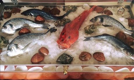 1 kg di grigliata di pesce sul lungomare di Tirrenia per 2 o 4 persone al Ristorante Pizzeria Chichibio (