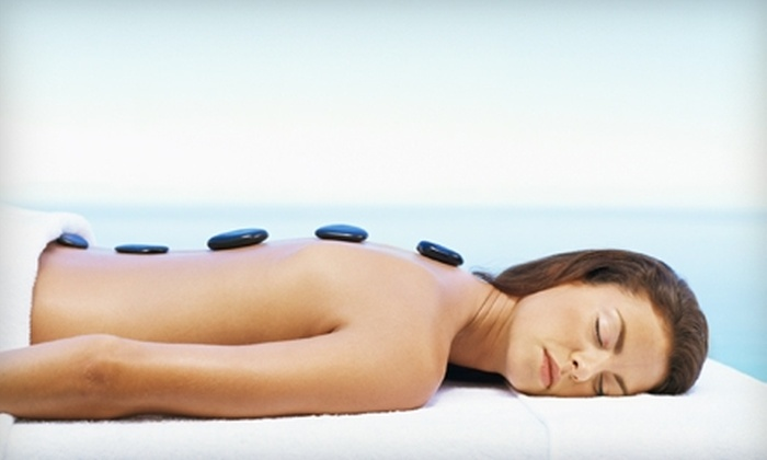 Artists in Motion Massage Therapy - Greensboro: $27 for Hot Bamboo & Hot Stone Massage at Artists in Motion Massage Therapy in Greensboro ($55 Value)