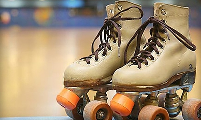 Holiday Skate Center - Orange: $12 for Two Admissions, Two Roller-Skate Rentals, Two Large Sodas and Two Popcorns at Holiday Skate Center in Orange (Up to $27.50 Value)