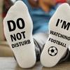 Socken mit Fußball-Slogan