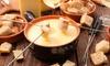 Fondue, formaggi gourmet e vino