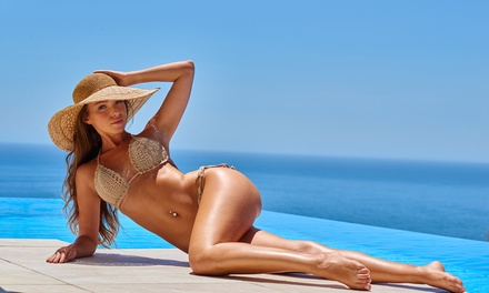 Spray Tanning: One $19, Three $55 or Five Sessions $85 at Mermaid Tan Up to $175 Value