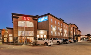 Service Plus Inn and Suites: 1-Night Stay for Up to Four with Optional Family Package at Service Plus Inn and Suites in Calgary, AB