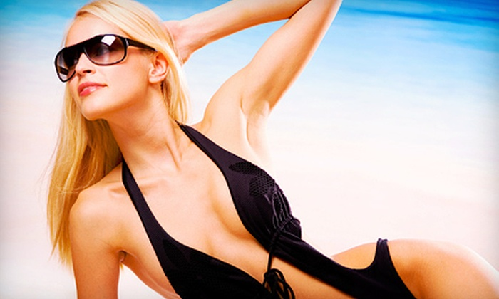 Tan Around The World - Greensburg: One Month of Unlimited UV Tanning or Three Custom Airbrush Tans at Tan Around The World in Greensburg (Up to 67% Off)