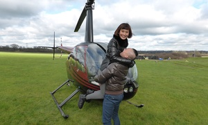 Flying Pig Helicopters: Romantic Helicopter Flight with Bubbly and Chocolates for Two with Flying Pig Helicopters