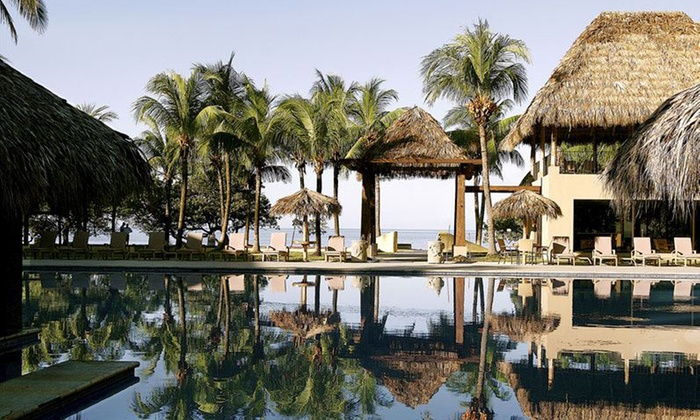 Flamingo Beach Resort Spa Stay With Air From Vacation Express