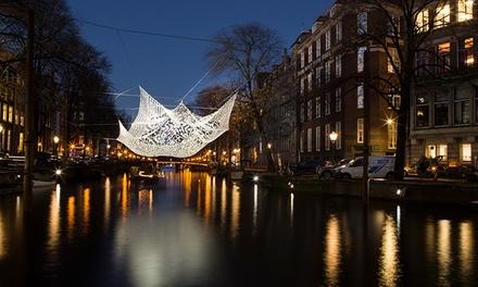 Privéboot voor max. 12 pers. incl. warm welkomstdrankje tijdens het Amsterdam Light Festival bij KINboat