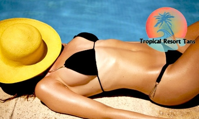 Tropical Resort Tans - Multiple Locations: $20 for One Month of Unlimited Tanning in any Bed Level or Four Mystic Tans at Tropical Resort Tans ($80 Value)