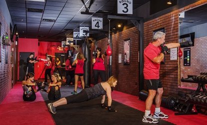 image for Two Weeks of Unlimited Workouts with a Trainer w/ Optional Gym Bag or Wraps at 9Round (Up to 56% Off)