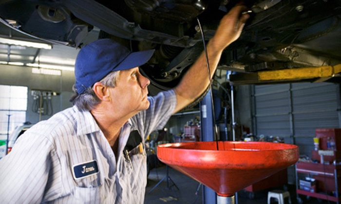 Extra Mile Automotive - Santa Cruz: Three or One Oil Changes and Tire Rotations at Extra Mile Automotive (82% Off)