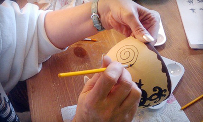 Fired Up Paint Your Own Pottery Studio - Clearwater: $19 for Two Wineglasses or Coffee Mugs Plus Complimentary Glass of Wine at Fired Up Paint Your Own Pottery Studio in Largo