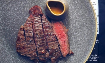 Steak Meal with Side and Glass of Wine for Two or Four at The Carnivore