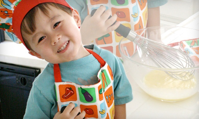 Handstand Kids: $22 for a Kids' Cookbook and Apron from Handstand Kids ($45 Value)