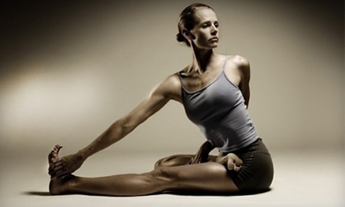 Flow Yoga Studio - Tracy: $50 for 10 Drop-In Pilates or Zumba Classes at Flow Yoga Studio in Tracy